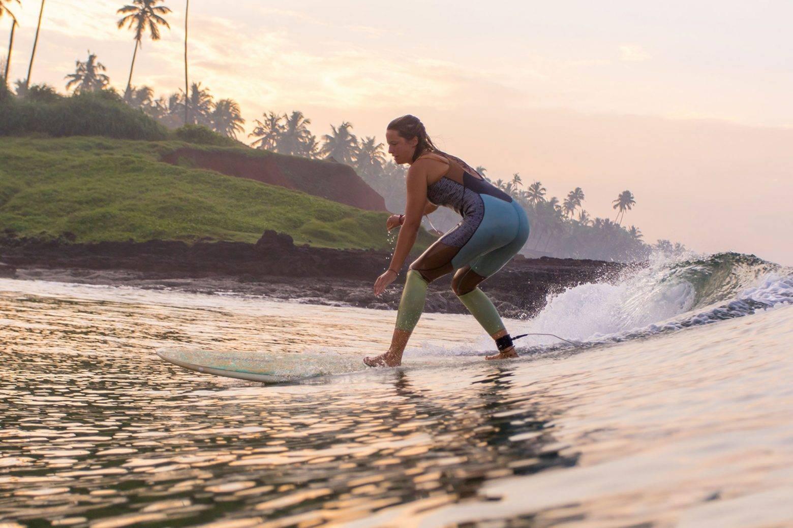 https://www.soulandsurf.com/wp-content/uploads/2021/04/Girl-surfing-Edava-e1627398425416.jpg