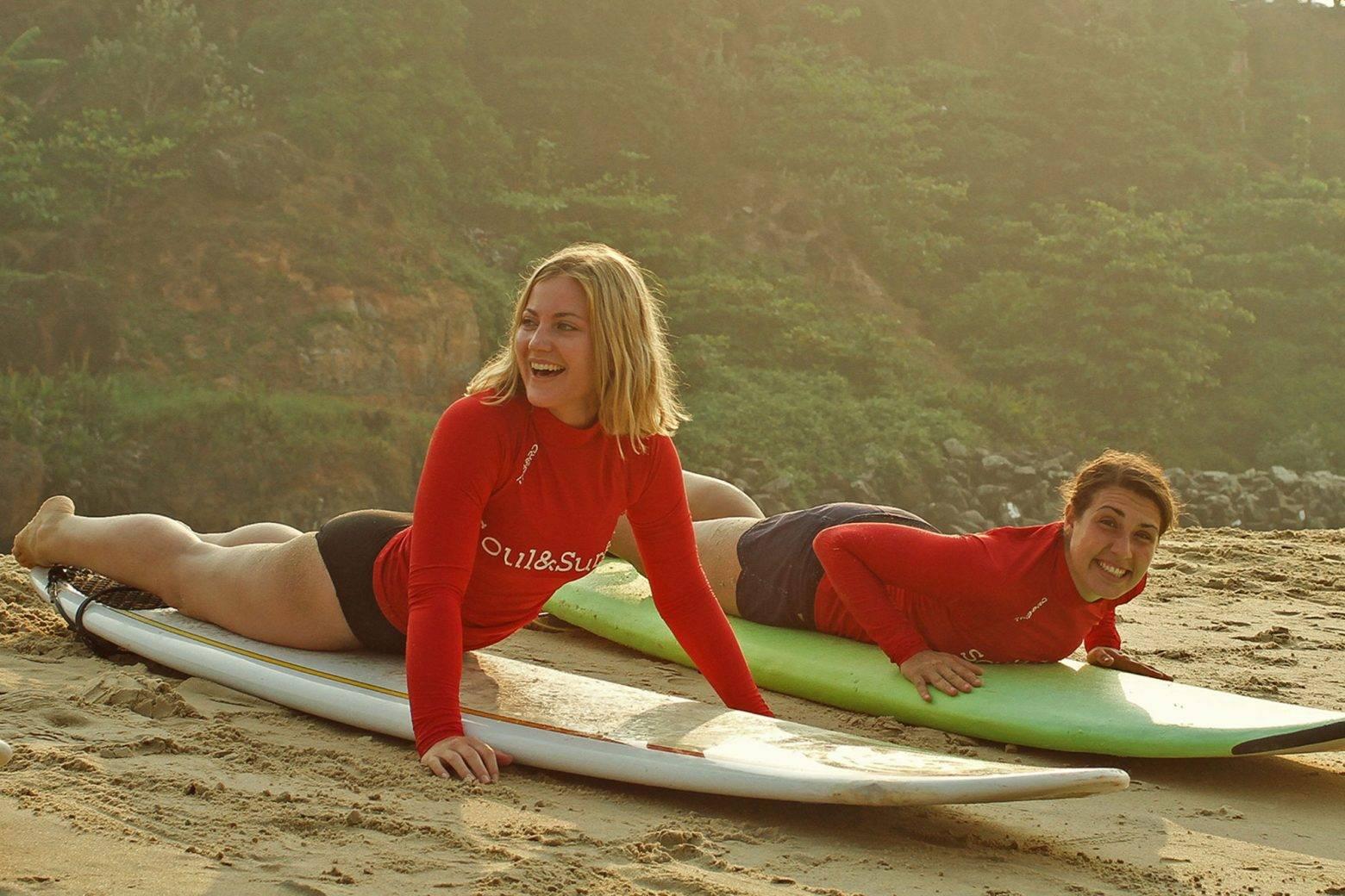 https://www.soulandsurf.com/wp-content/uploads/2021/04/Surf-lesson-in-red-rash-vests-e1627398837364.jpg Image