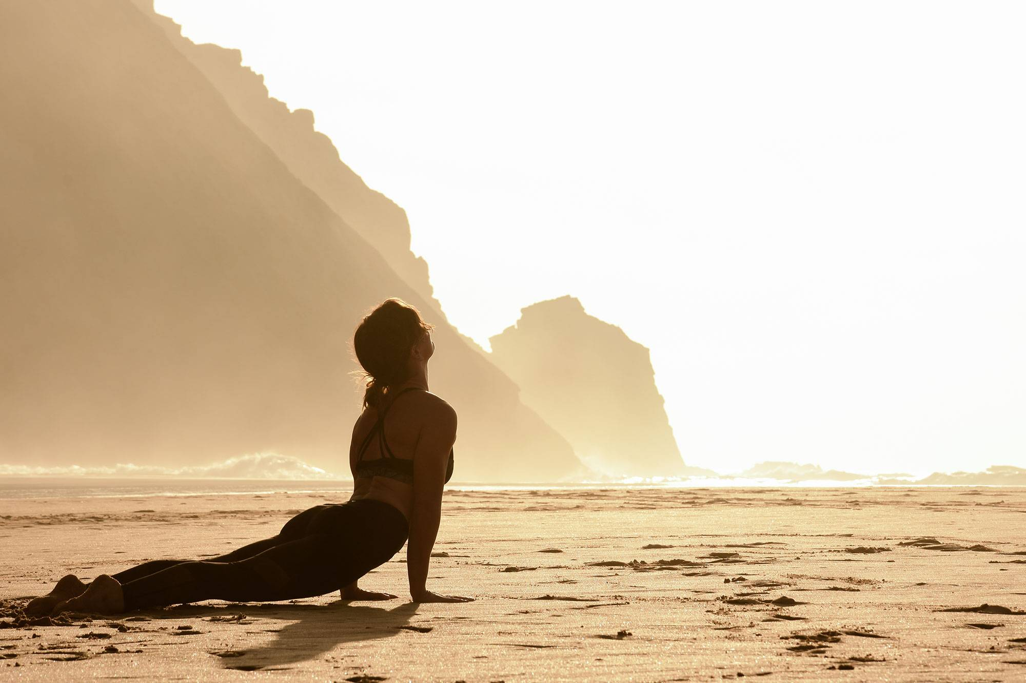 https://www.soulandsurf.com/wp-content/uploads/2021/07/retreatsportugal-images@katiearaephoto_Yoga_On-the-beach_Rach.jpg