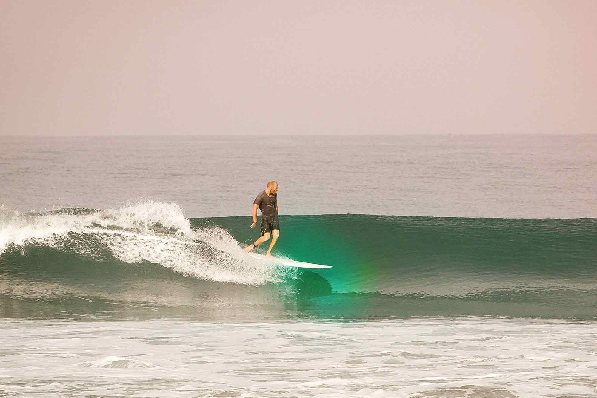 https://www.soulandsurf.com/wp-content/uploads/2021/09/Retreatsindia-images-Surfer-Going-Left-Edava.jpg